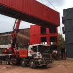 container lifted by crane truck